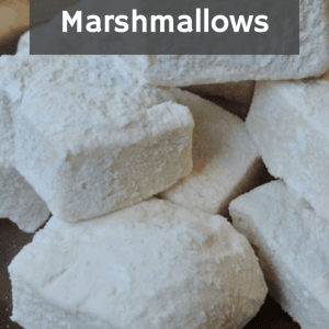 """Homemade Marshmallows Recipe"" data-pin-description= ""Making homemade marshmallows is much easier than you think! Not only do they far surpass store bought marshmallows, these marshmallows actually offer your body some nutrition. Your body won't miss the chemicals, additives, and high fructose corn syrup. I promise! #homemademarshmallows #homemademarshmallowrecipe #camping #smores #realfood #summerfun #reclaimingvitality"" />"